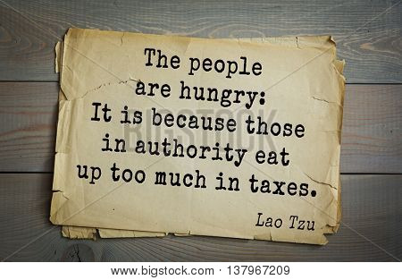 Ancient chinese philosopher Lao Tzu quote on old paper background.  The people are hungry: It is because those in authority eat up too much in taxes.