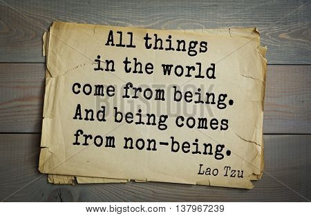 Ancient chinese philosopher Lao Tzu quote on old paper background. All things in the world come from being. And being comes from non-being.