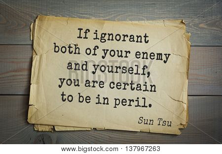 Ancient chinese strategist and philosopher Sun Tzu quote on old paper background. If ignorant both of your enemy and yourself, you are certain to be in peril.