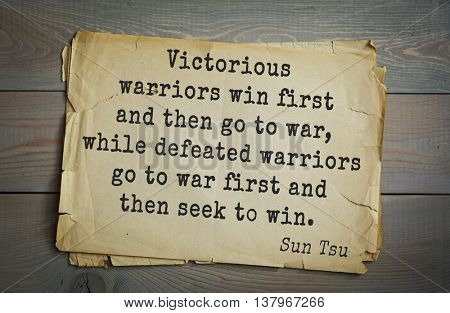 Ancient chinese strategist and philosopher Sun Tzu quote on old paper background. Victorious warriors win first and then go to war, while defeated warriors go to war first and then seek to win.