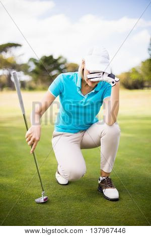 Full length of woman hiding face at golf course