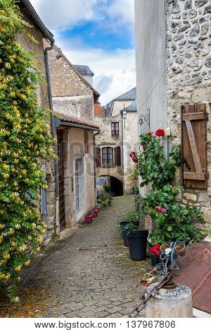 Narrow street in the village of Angles-sur-l'Anglin, France
