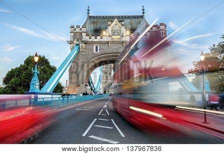 Entrance to the Tower Bridge in London with blurred traffic
