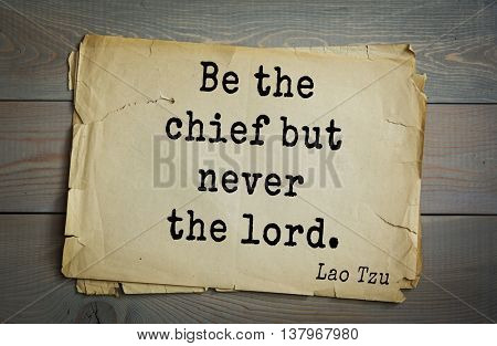 Ancient chinese philosopher Lao Tzu quote on old paper background.  Be the chief but never the lord.