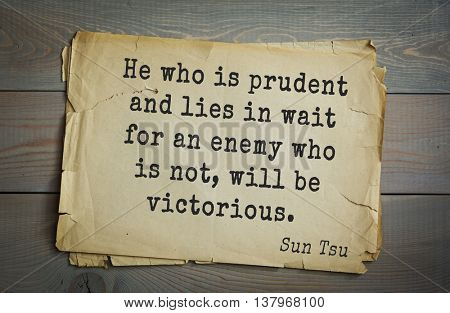 Ancient chinese strategist and philosopher Sun Tzu quote on old paper background. He who is prudent and lies in wait for an enemy who is not, will be victorious.