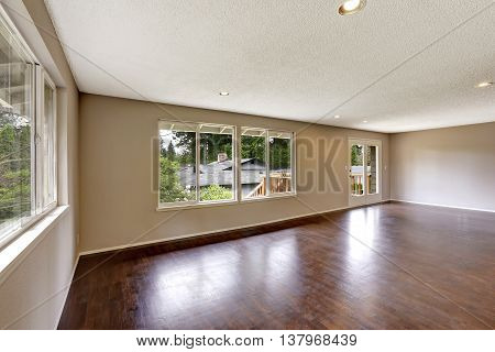 Empty House In Light Ivory Color With Hardwood Floor