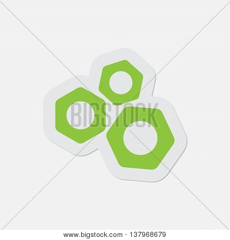 simple green icon with contour and shadow - three nuts on a white background, vector