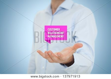 Customer relationship management (CRM) concept. Businessman hold virtual label with Customer Relationship Management text.