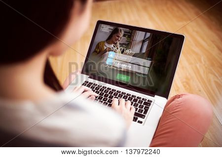 signup screen with blonde girl and pad against asian woman using laptop with copy space