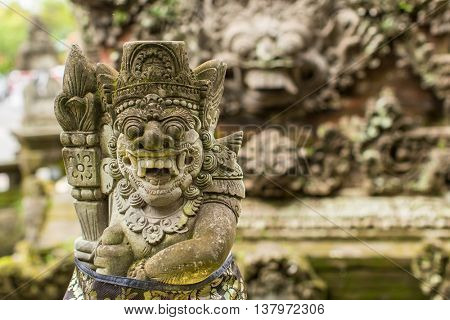 Traditional demon guards statue in Bali island.