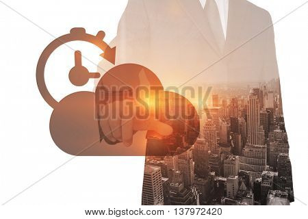 Businessman pointing against digitally generated image of cloud with timer