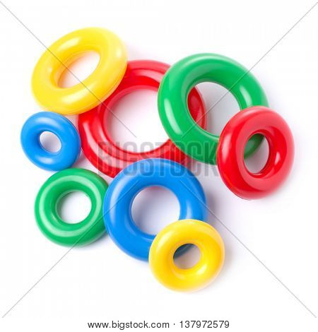 Multicolored plastic rings isolated on white background.
