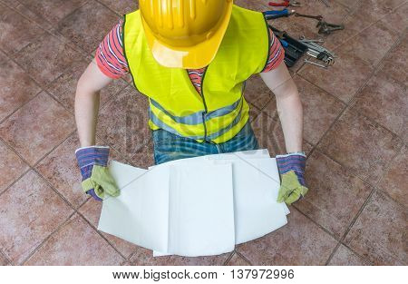 Worker Is Holding Empty Paper For Custom Message. Top View.