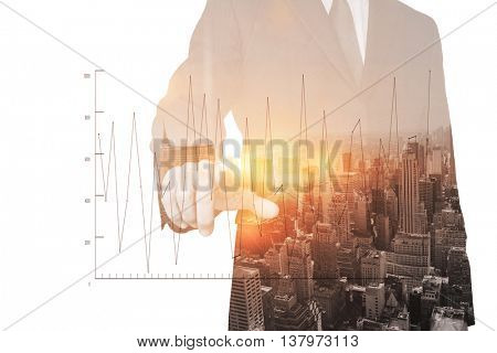 Businessman pointing against digitally generated image of line graph