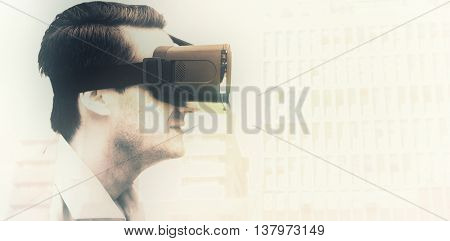 Profile view of businessman holding virtual glasses against low angle view of city buildings