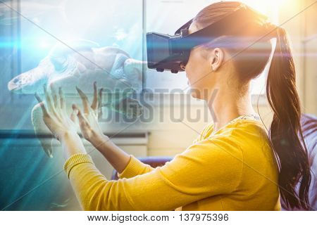 Sea turtle swimming with fish in tank against business woman using 3d glasses