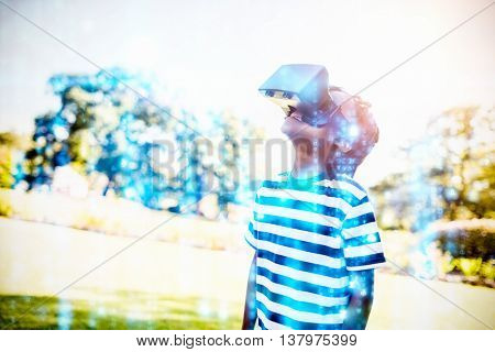 Digitally generated black and blue matrix against child looking in 3d glasses