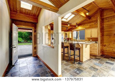 Hallway With Opened Door. View To Backyard. Opened Plan Kitchen.