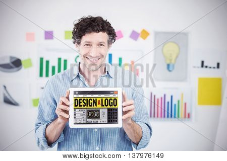 Businessman showing digital tablet with blank screen in creative office against webpage for create a logo