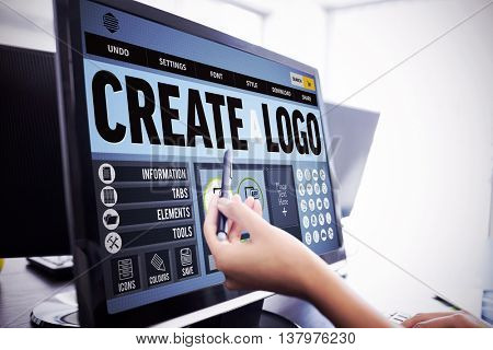Webpage for create a logo against casual businesswoman touching her computer Casual businesswoman touching her computer with a pen