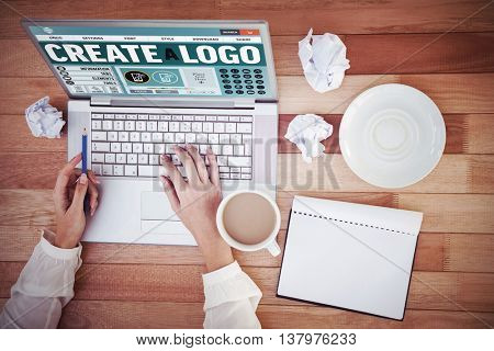 Webpage for create a logo against cropped image of woman with pen using laptop