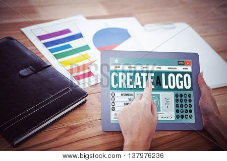Webpage for create a logo against over shoulder view of hipster woman using tablet