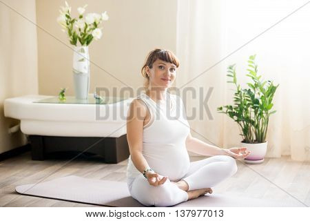 Portrait Of Pregnant Yoga Woman Meditating
