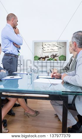Business team looking at white screen against energy efficient house graphic against a background