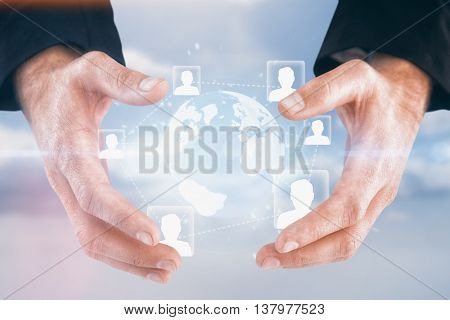 Businessman holding hand out in presentation against blue sky