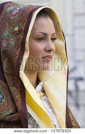 SELARGIUS, ITALY - September 14, 2014: Former marriage Selargino - Sardinia - portrait of a beautiful girl in traditional Sardinian costume
