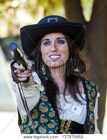 SELARGIUS, ITALY - October 19, 2014: The enchanted garden in Cosplay - 2nd edition - Sardinia - portrait of a beautiful woman with gun in cosplay costume