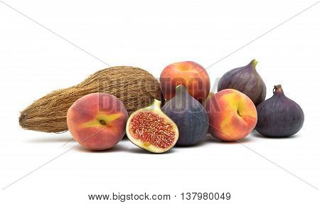 figs peaches and coconut isolated on white background. horizontal photo.