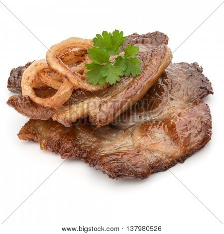 Cooked fried pork meat with parsley herb leaves and onion slices garnish isolated on white background cutout