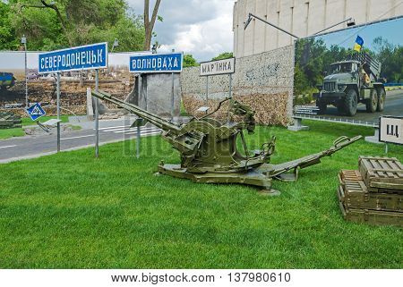 Dnepropetrovsk Ukraine - May 19 2016: Open air museum dedicated to war in the Donbass. Anti-aircraft machine gun and ammunition