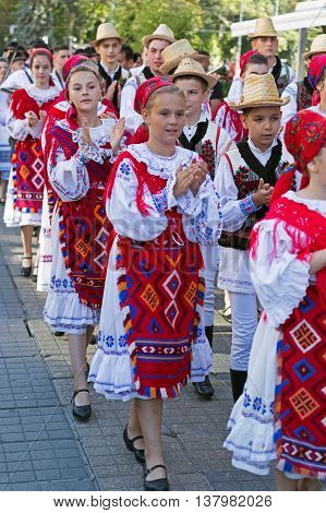 ROMANIA; TIMISOARA - JULY 7 2016: Child and teens from Romania in traditional costume; present at the folk festival International Festival of hearts