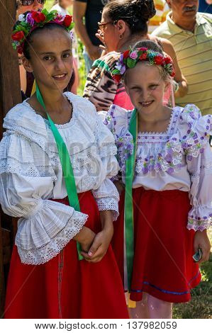 ROMANIA TIMISOARA - JUNE 7 2015: Girls from Ukraine in traditional costume present at the ethnic Festival organized by the City Hall Timisoara.