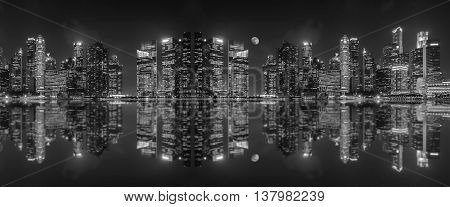 Panoramic view of a megalopolis skyscrapers with reflection of Singapore city. Black and white tone.