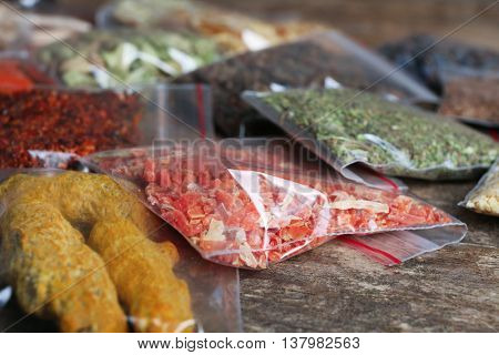 Different spices in plastic zipper bags