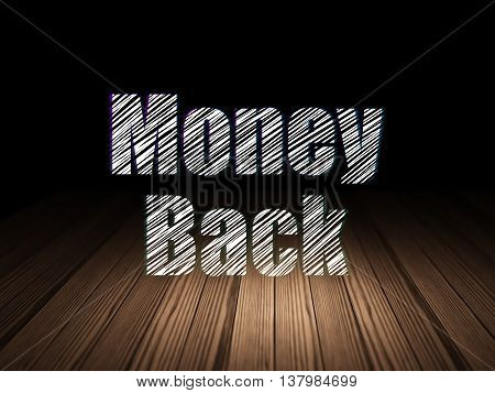 Business concept: Glowing text Money Back in grunge dark room with Wooden Floor, black background