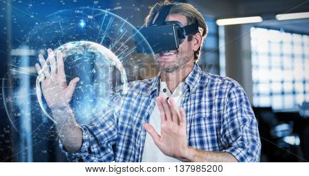 Image of earth with different times against businessman using virtual reality simulator