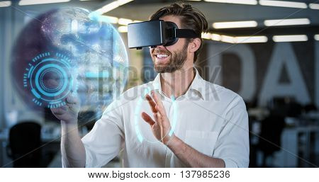 Earth globe against businessman gesturing while using virtual reality simulator