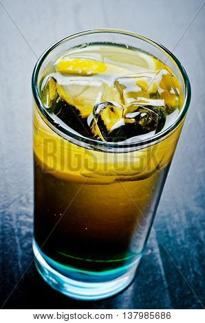 cold whiskey and coke with lemon and ice for the menus served in restaurants clubs bars cafes