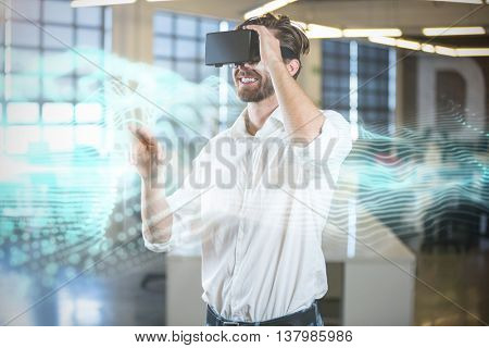 Abstract blue glowing black background against businessman smiling while using virtual reality simulator
