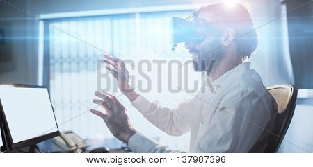 Businessman wearing virtual glasses in a office