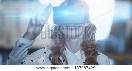 Smiling woman wearing virtual reality glass in office