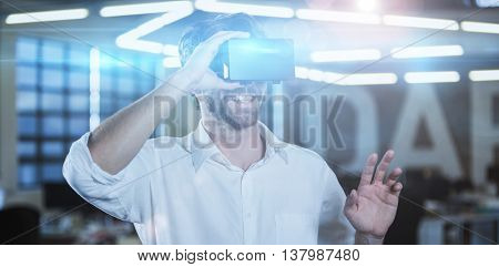 Cheerful businessman wearing virtual reality simulator in office