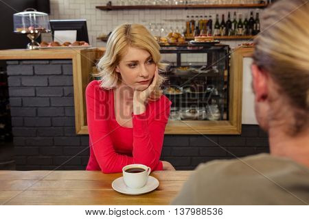 Couple having relationship difficulties in the cafe