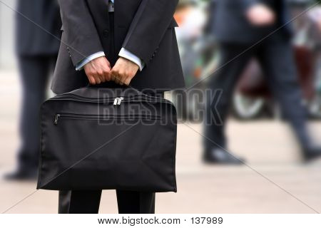 Business Man Holding Briefcase At Rush Hour
