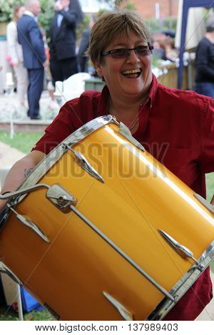 2ND JULY 2016, PORTSMOUTH,ENGLAND: An unknown drummer with her drum at a wedding in Portsmouth, England, 2nd july 2016