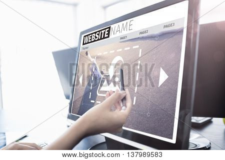 Composite image of build website interface against casual businesswoman touching her computer Casual businesswoman touching her computer with a pen